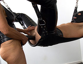 Mistress thrusting strapon into slaves ass-Picture1