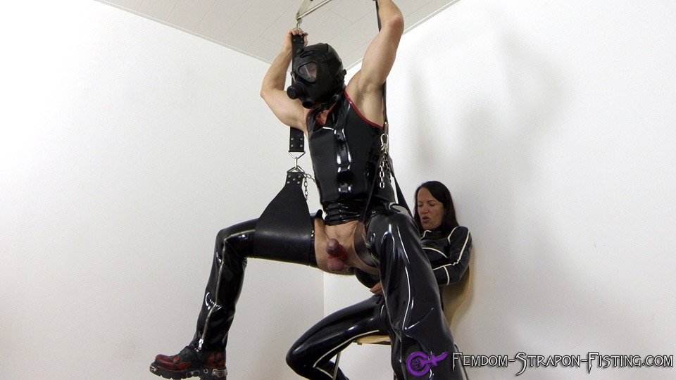 Domina fucks male slave on a sex swing with a giant strapon
